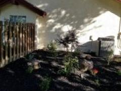 landscaping with custom fence